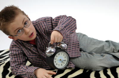 Image: boy with clock